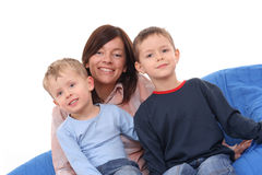 Mother and sons. Mother and two sons on the sofa Stock Photo