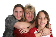 Mother & Sons. An attractive mother and her two teen sons, isolated Royalty Free Stock Image