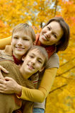 Mother and sons. In the autumn park Royalty Free Stock Images