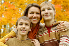 Mother and sons. In the autumn park Stock Photography