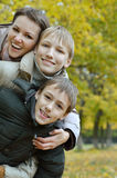 Mother and sons. In the autumn park Royalty Free Stock Photo