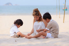 Mother and sons on beach Royalty Free Stock Images