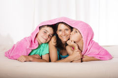 Mother and sons in bed Royalty Free Stock Images