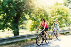 Mother with sons on bicycle trip Stock Image