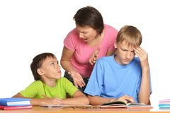 Mother and sons doing homework. Together isolated on white background Royalty Free Stock Photography