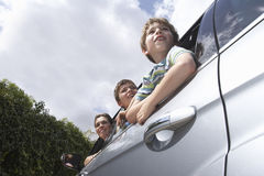 Mother With Sons Leaning Through Car Window Stock Photography