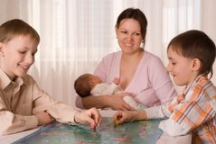 Mother with  sons and newborn Stock Images
