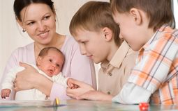 Mother with  sons and newborn Stock Photography