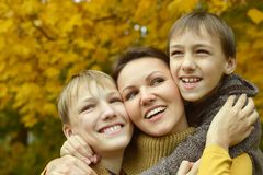 Mother and sons in park. Happy  Mother and sons in the autumn park Stock Images