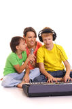 Mother and sons with piano Royalty Free Stock Photo