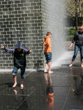 Mother and sons play in Crown Fountain, Millennium Park, Chicago Royalty Free Stock Photography