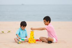 Mother and sons are playing on tropical beach Stock Photo