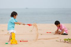 Mother and sons are playing on tropical beach Royalty Free Stock Image