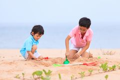 Mother and sons are playing on tropical beach Stock Photography