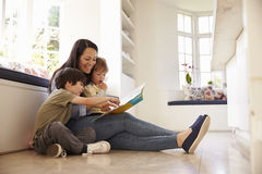 Mother And Sons Reading Story At Home Together Royalty Free Stock Image