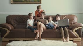 Mother with sons spends leisure time at home stock video