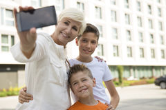 Mother and sons taking a selfie royalty free stock photography