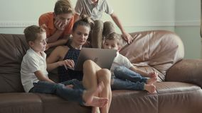 Mother with sons watches movie at laptop at home stock video