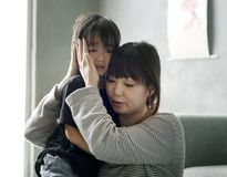 Mother sooth her daughter from sadness Stock Photo