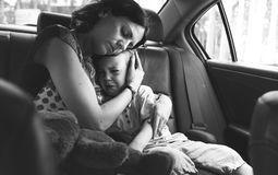 Mother Soothe Her Son Crying in the Car Stock Images