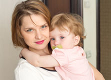 Mother soothes the baby. Mother soothes the child on hands Royalty Free Stock Photos