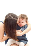 Mother soothes a crying baby girl. On a white background Stock Image