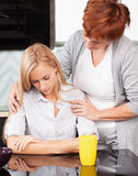 Mother soothes sad daughter Stock Photo