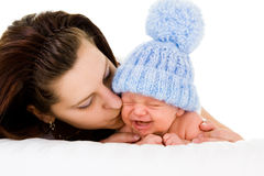 Mother soothing crying baby Stock Photos
