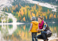Mother speaking to daughter on the shore of Lake Bries Royalty Free Stock Photo