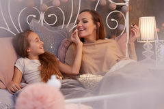 Mother spending evening with daughter Royalty Free Stock Photo