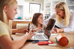 Mother spending time with daughters at home Royalty Free Stock Photography
