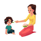 Mother spoon feeding her little daughter sitting on the floor. Cartoon vector illustration isolated on white background. Mother, mom holding bowl of porridge Stock Photography