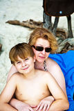 Mother is spooning with her happy smiling son Royalty Free Stock Images