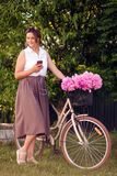 Mother stands with a bicycle royalty free stock image