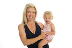 Mother Stands, Holding Toddler Daughter Royalty Free Stock Images