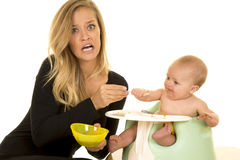 Mother stress feed baby Royalty Free Stock Photography