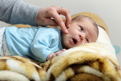 Mother stroking cheek little newborn baby boy Stock Photography