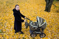 Mother with a stroller. Stock Photos