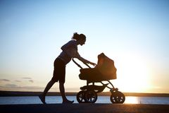 Mother with a stroller stock image