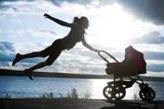 Mother with a stroller Royalty Free Stock Photography