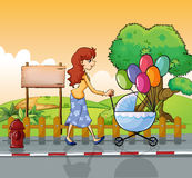 A mother strolling with a stroller Stock Image