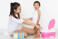 Mother successfully teaches child potty training Royalty Free Stock Photo
