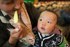 Mother and Sun, Tibetan People stock photography