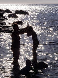 Mother and sun in the water in Corsica. On a summer day Stock Image