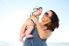 Mother on sunny beach. Royalty Free Stock Image