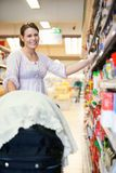 Mother in Supermarket Royalty Free Stock Photography