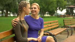 Mother supporting her daughter, sharing her life experience, girlish secrets stock video footage
