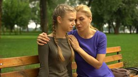 Mother supporting her sad daughter, problems with studying, adolescence. Stock footage stock video footage