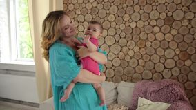 Mother and sweet baby girl dancing at home. stock video footage