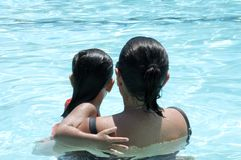 Mother swimming with daughter Royalty Free Stock Images